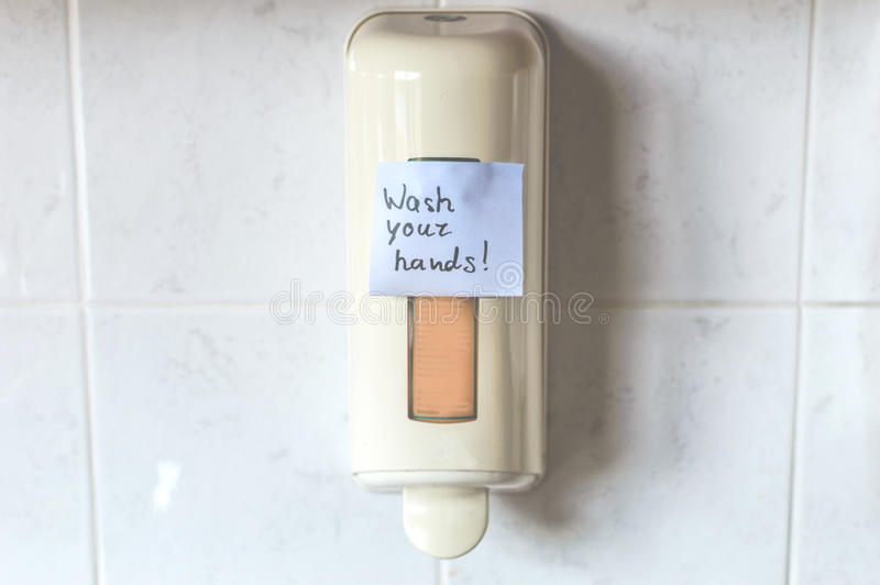Wash your hands with soap. Picture reminds us how important is to use quality soap at the work, home, education instances etc royalty free stock photo