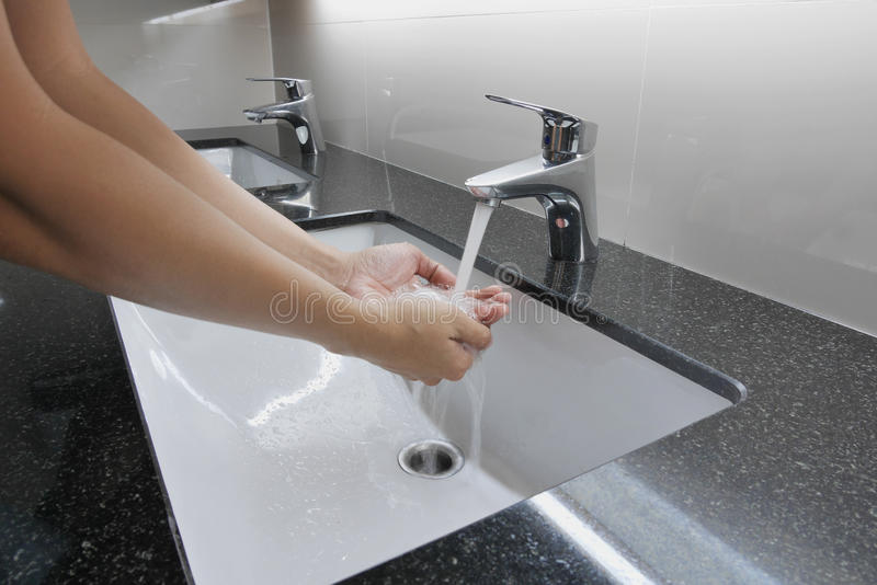 Washbasin And Faucet On Granite Counter With Hand Washing Stock ...