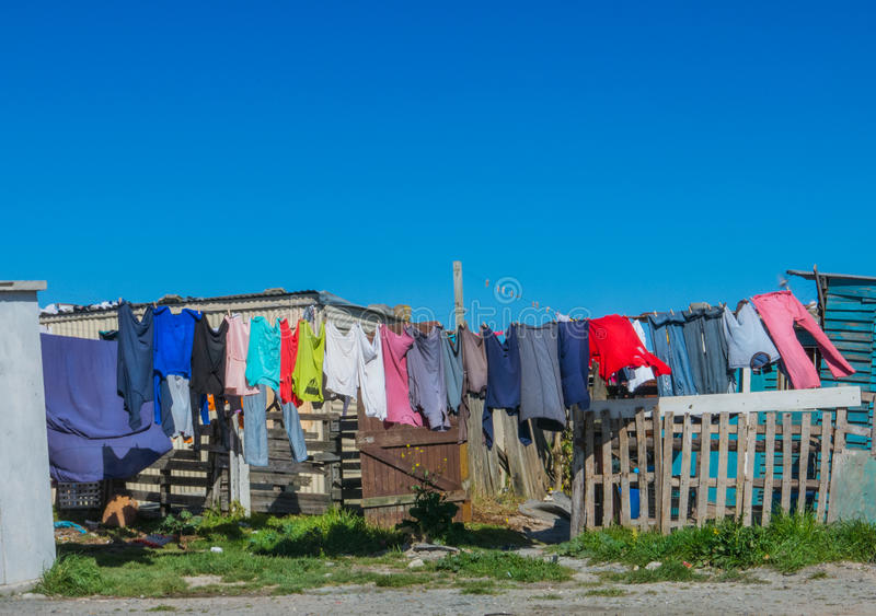 Washday in shanty town royalty free stock image