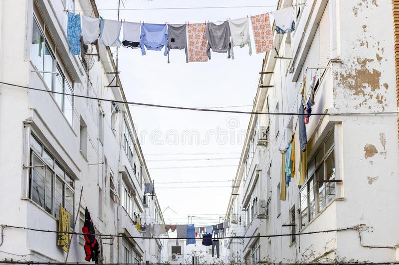 Washed clothes hanging between residencial buildings in Ayamonte, Spain royalty free stock photography