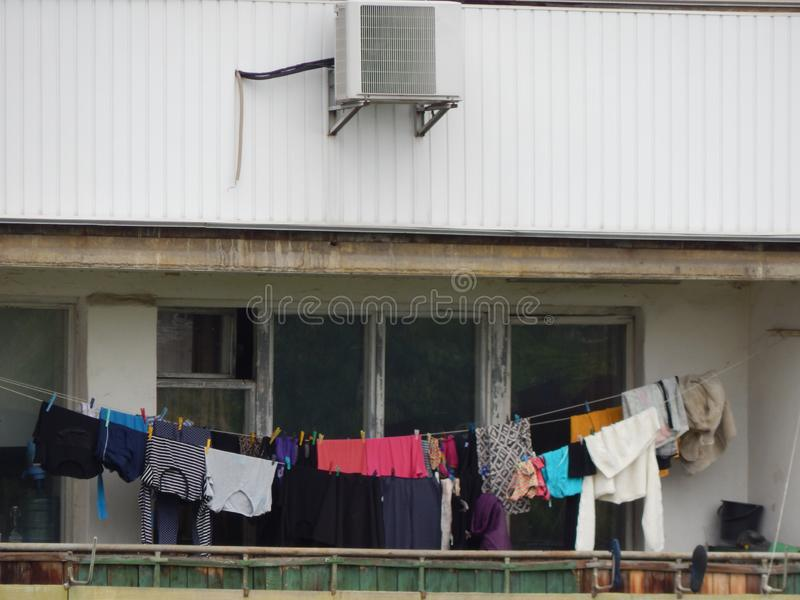 The washed laundry is dried on the balcony of the house. The washed laundry is dried on the balcony royalty free stock images