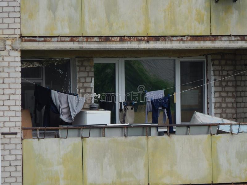 The washed laundry is dried on the balcony of the house. The washed laundry is dried on the balcony royalty free stock photo