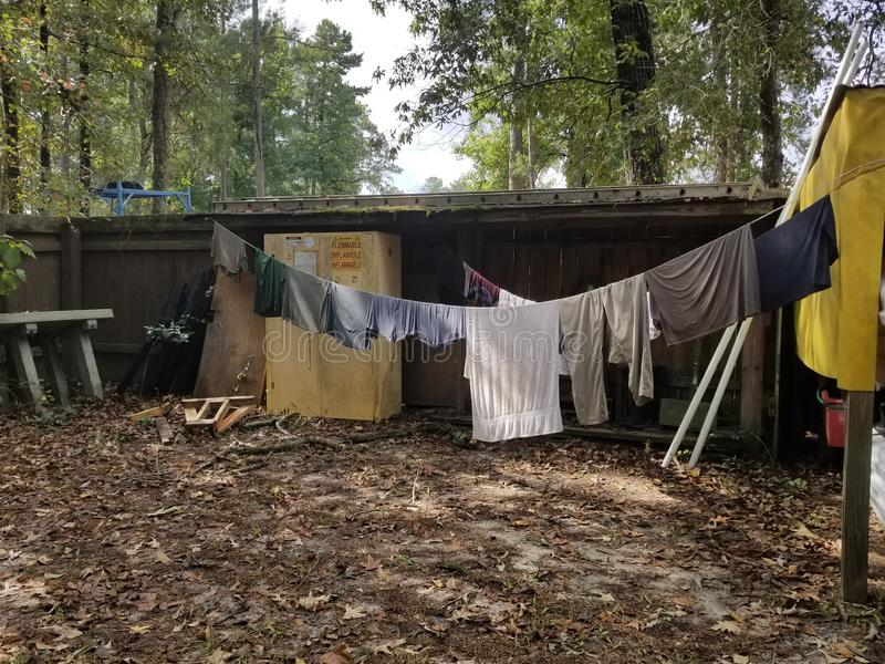 Clothes drying on rope stock image
