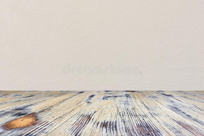 Washed wood table with concrete texture background royalty free stock image