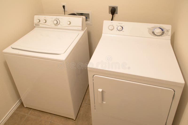 Washer and dryer in washroom background royalty free stock photos
