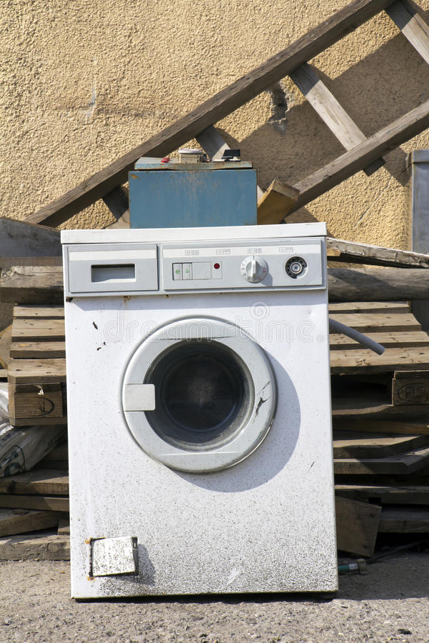 Washer. Old household appliances disposed of in metal scrapyard royalty free stock image