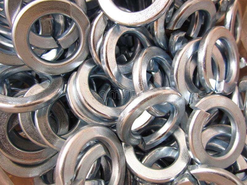 Washers engraver. Steel washers engraver for mounting construction parts royalty free stock photos
