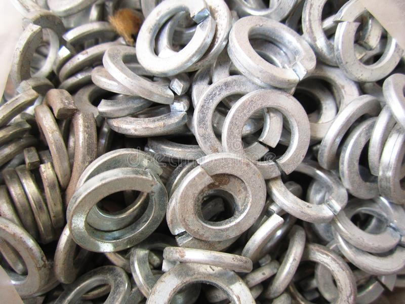 Washers engraver. Steel washers engraver for mounting construction parts stock photography