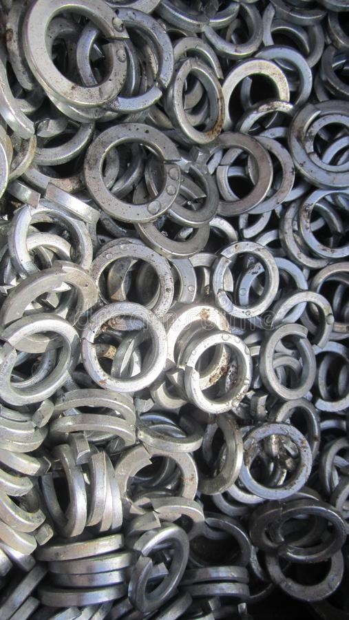 Washers engraver. Steel washers engraver for mounting construction parts stock images