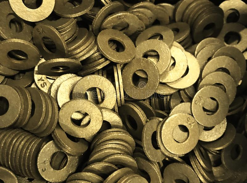 Washers, machined, brass/gold color, general purpose. Used in many commercial and industrial activities royalty free stock photo