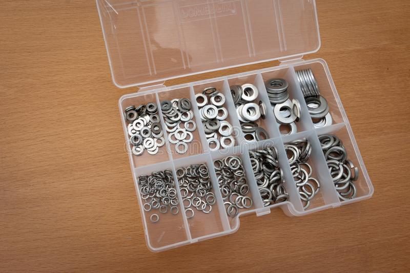 Washers in a tray full metal. For constructions and repair royalty free stock photography