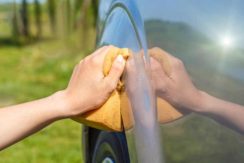 Washes the car. stock photo
