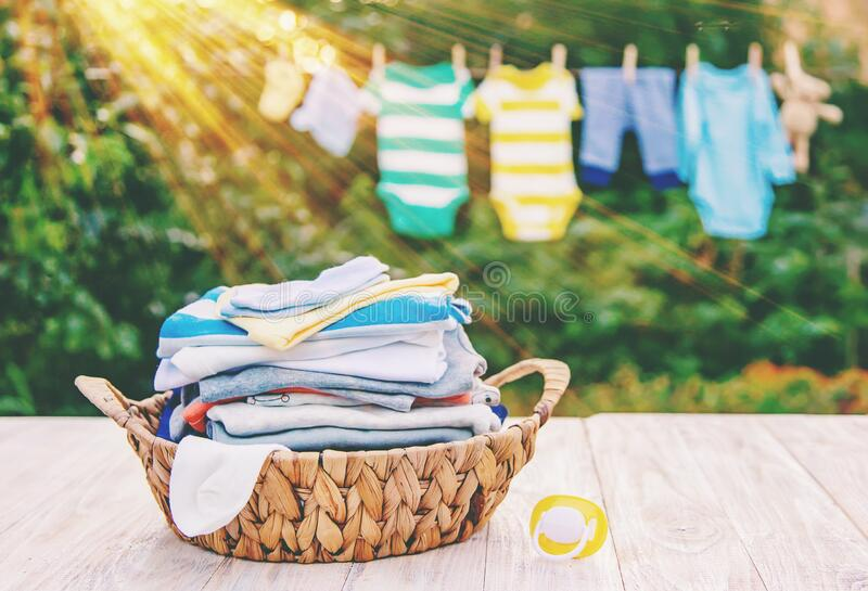 Washing baby clothes. Linen dries in the fresh air. Selective focus. Nature royalty free stock photography