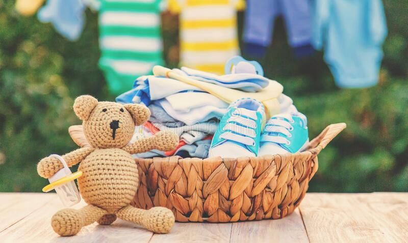 Washing baby clothes. Linen dries in the fresh air. Selective focus. Nature stock photos