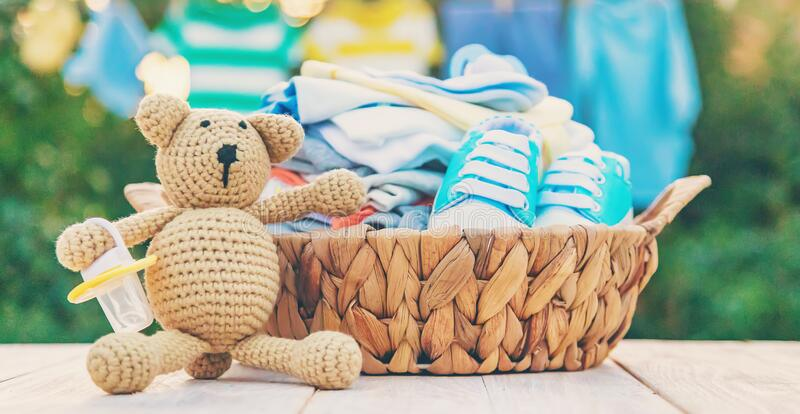 Washing baby clothes. Linen dries in the fresh air. Selective focus. Nature stock image