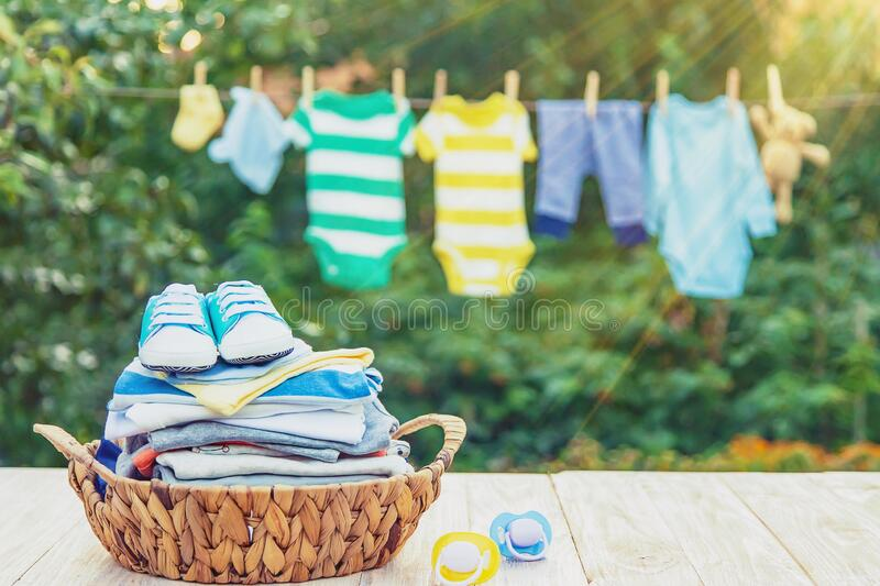 Washing baby clothes. Linen dries in the fresh air. Selective focus. Nature royalty free stock images