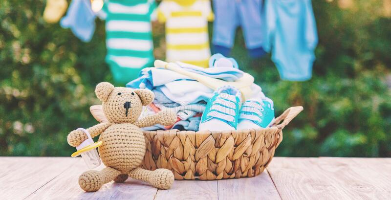 Washing baby clothes. Linen dries in the fresh air. Selective focus. Nature royalty free stock image