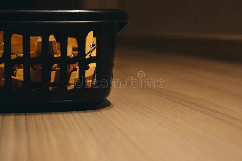 Washing basket on wooden floor stock images