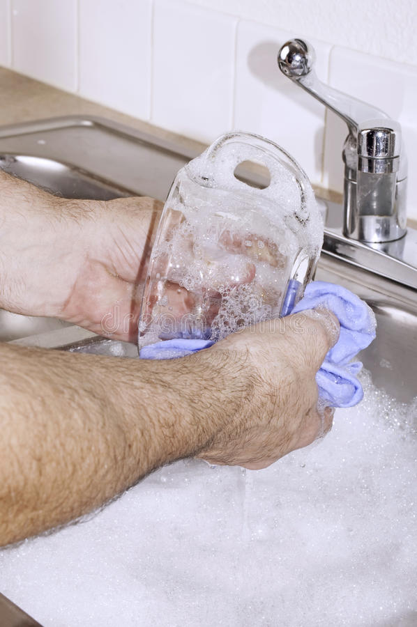 Washing a bowl by hand stock photos