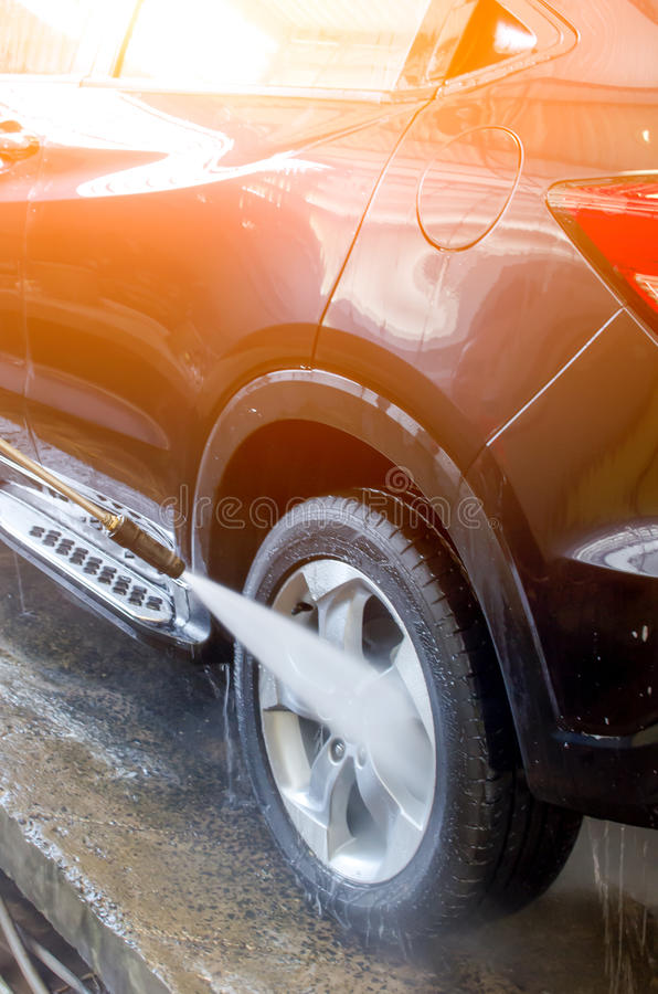 Washing Car Using High Pressure Water. stock photography