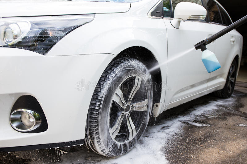 Washing car wheel with high pressure water stock photos