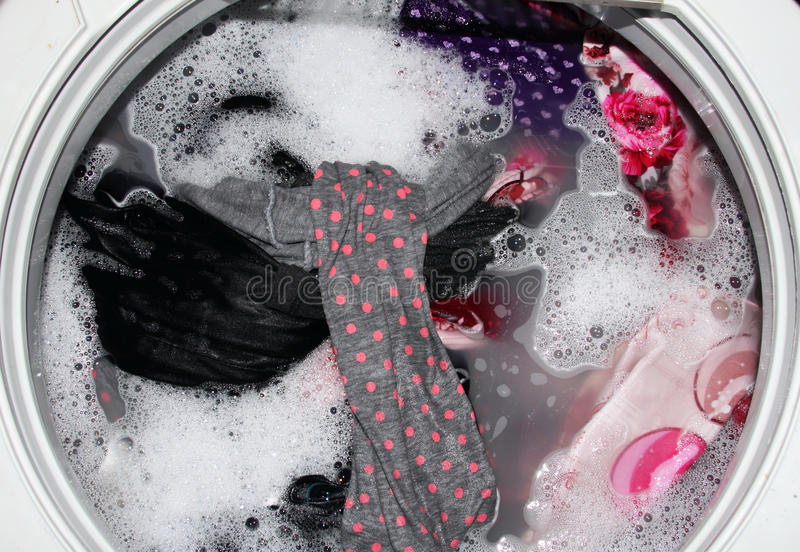 Washing clothes. In washing machine royalty free stock image