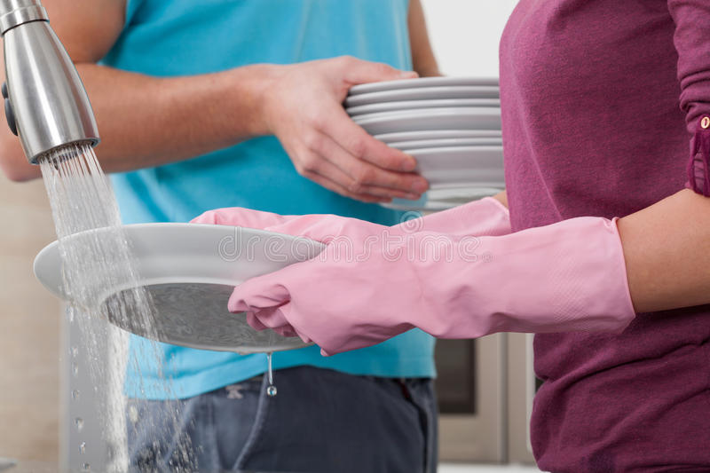 Washing the dishes stock photos