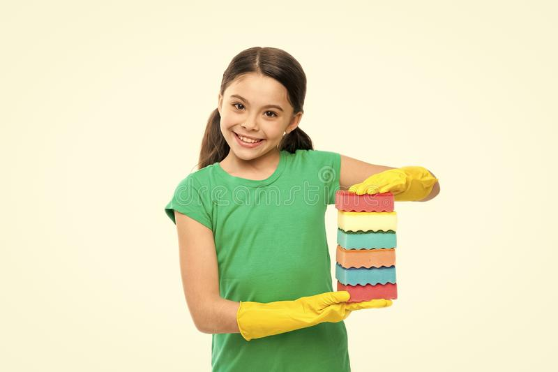 Washing the dishes is my job. Small housekeeper holding dish sponges in rubber gloves. Little housemaid ready for. Household help. Adorable kitchen maid stock image