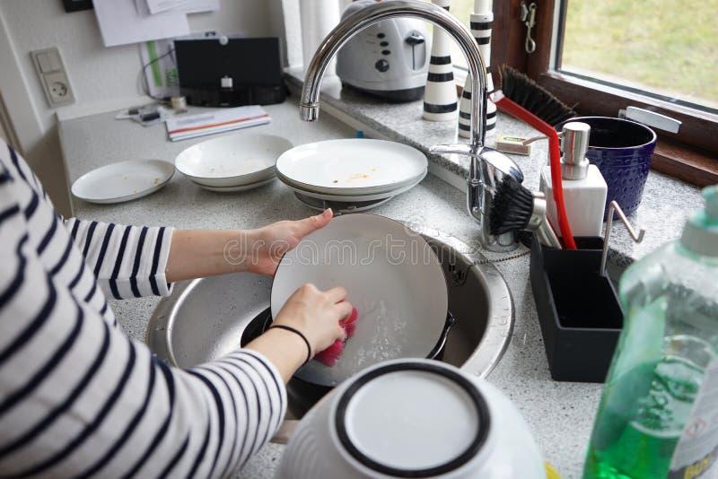 Washing dishes stock images