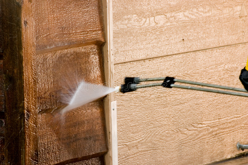 Washing the Garage. The side of a garage being pressure washed royalty free stock photos