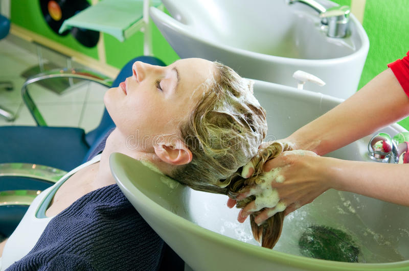 Washing hair royalty free stock images