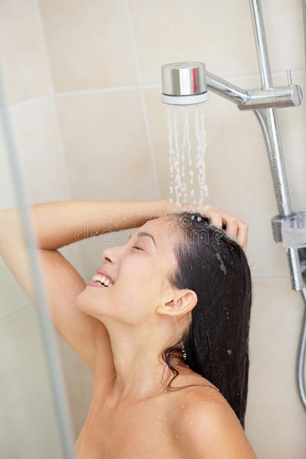 Washing hair - shower woman royalty free stock images