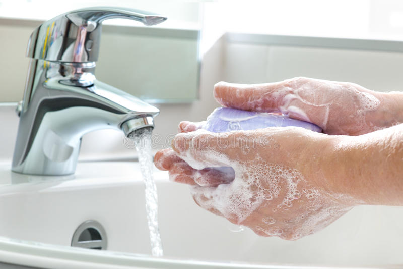 Washing hands stock photos
