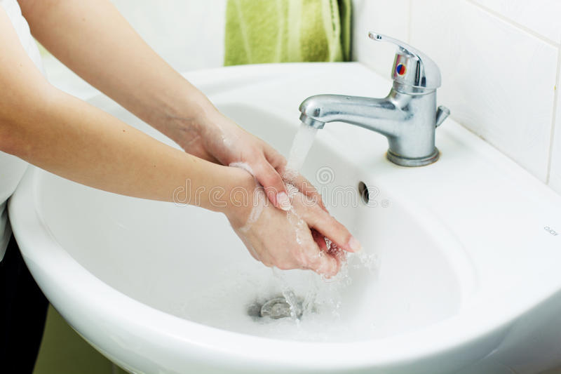 Washing Hands. With streaming water in bathroom. Hygiene stock photo
