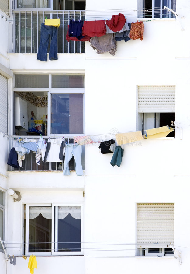 Washing hanging from windows in Spain stock photo