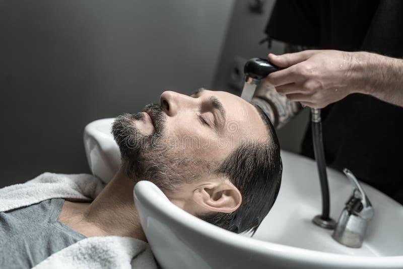 Washing head in barbershop stock image. Image of hand - 80357919