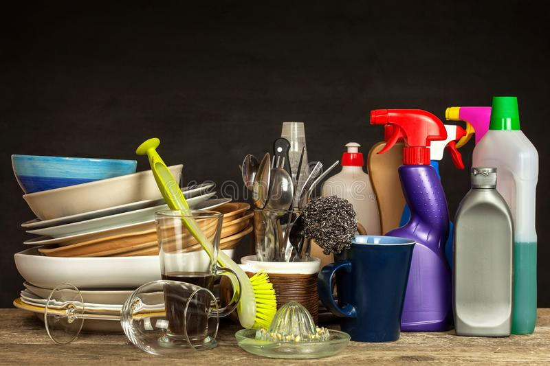 Washing kitchenware. Crockery on a wooden table. Cleaning after home celebration. Housework. stock images
