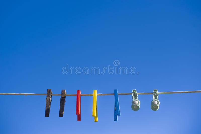 Download Washing Line Against Bright Blue Sky Stock Photo - Image: 13022610