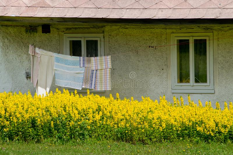 Washing line in front of old house. Bohemian Forest. Czech Republic stock photos