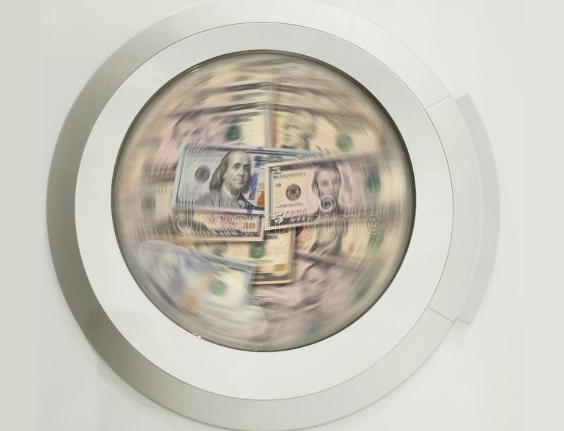 Washing machine cleaning lots of dollar banknotes - concpt showing money laundering, dirty money, hidden wages, salaries royalty free stock photos
