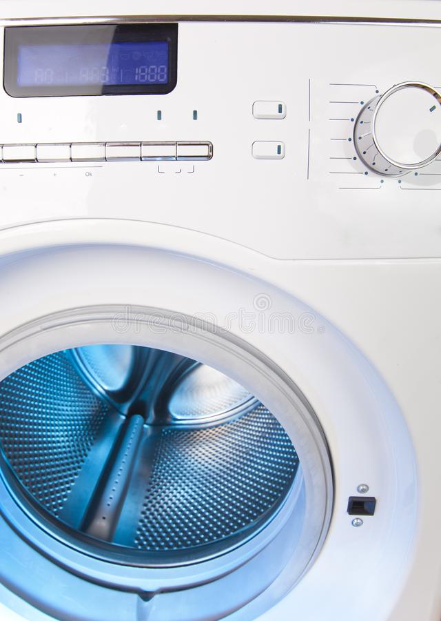 The washing machine - a close up of the display, the manhole and a choice of programs.  stock photography