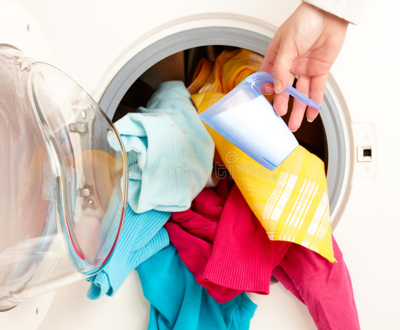 Washing machine with colorful clothes stock images