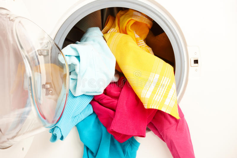 Washing machine with colorful clothes royalty free stock photography
