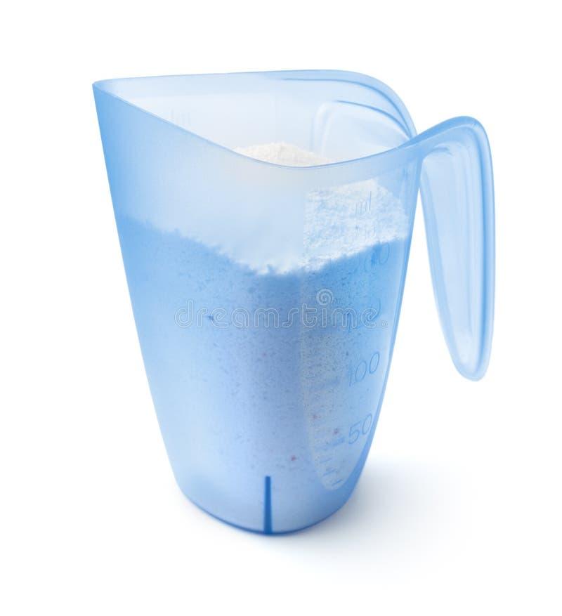 Washing powder in measuring cup royalty free stock image