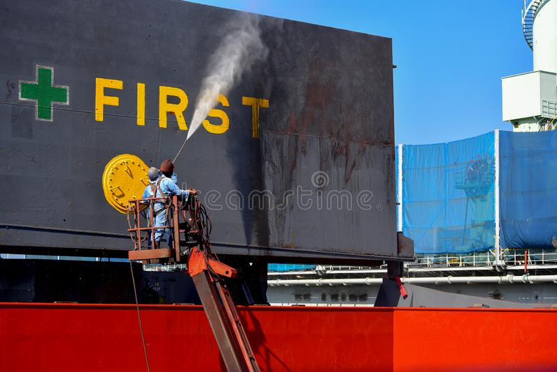 Washing ship by High pressure water jet stock image