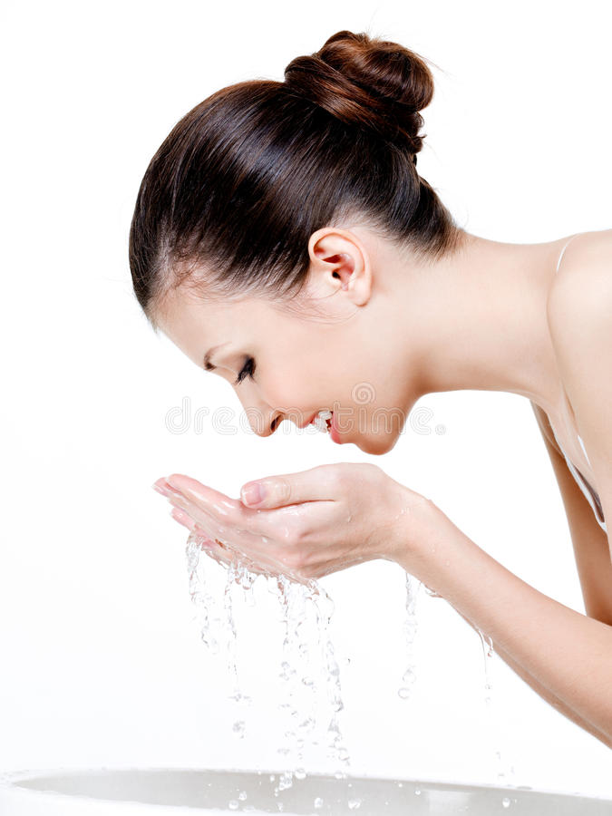 Washing woman's face royalty free stock photo
