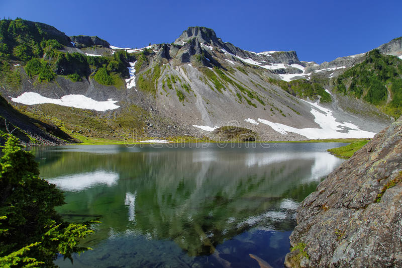 Washington Cascades. Reflections at Bagley Lake, near Mount Baker in the Cascades mountains of Washington stock photo