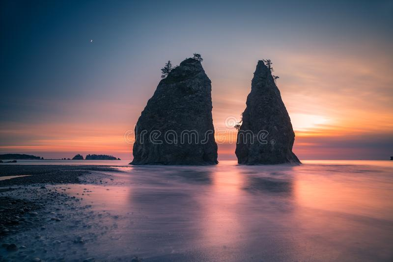 Olympic National Park - coast feature at dusk. The Washington coast feature with sunset and moon of Olympic National Park royalty free stock photos