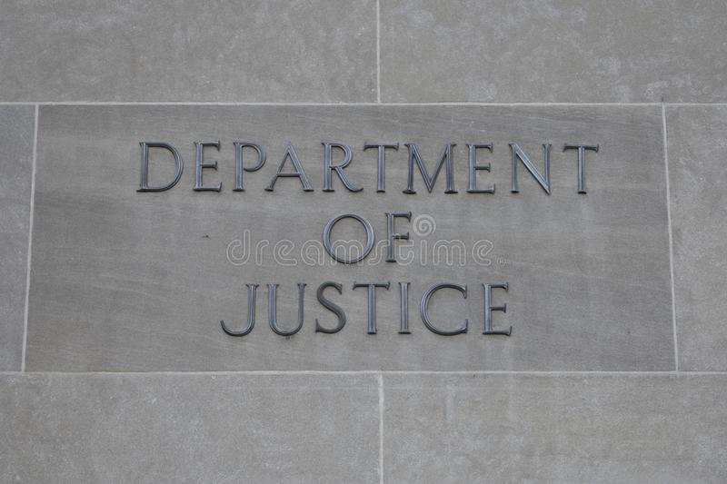 Department of Justice sign. Washington D.C., United States – October 23, 2017 : Department of Justice sign at the entrance to the United States of America stock image