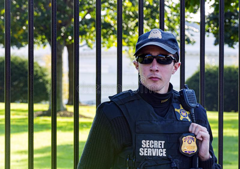 Young officer wearing sunglasses and the uniform of the American Secret Service guarding the White House in Washington D.C stock image